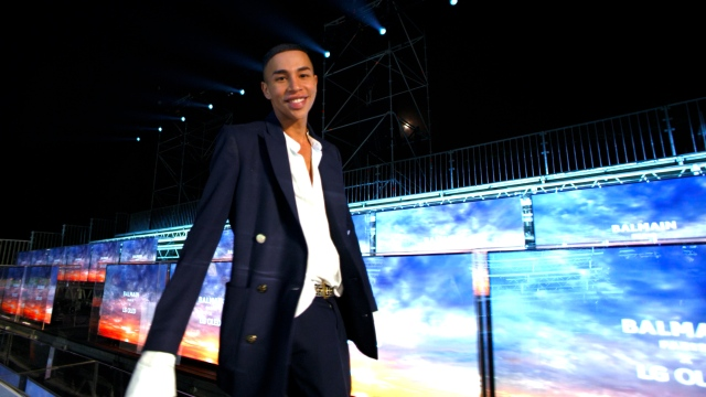 Balmain's Olivier Rousteing at Paris Fashion Week, set against a virtual front row equipped with LG displays.