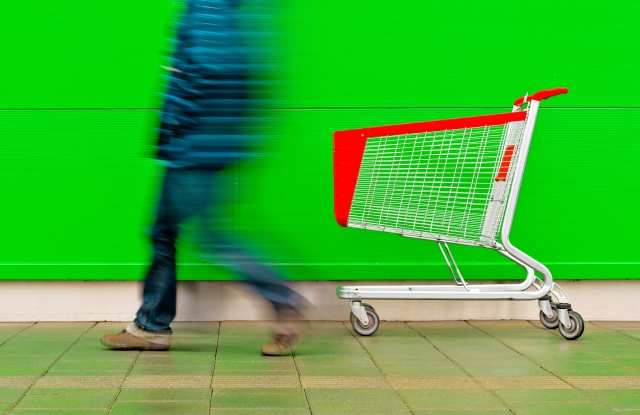 Man walking by empty shopping trolley. (Photo by: SCIENCE PHOTO LIBRARY via AP Images)