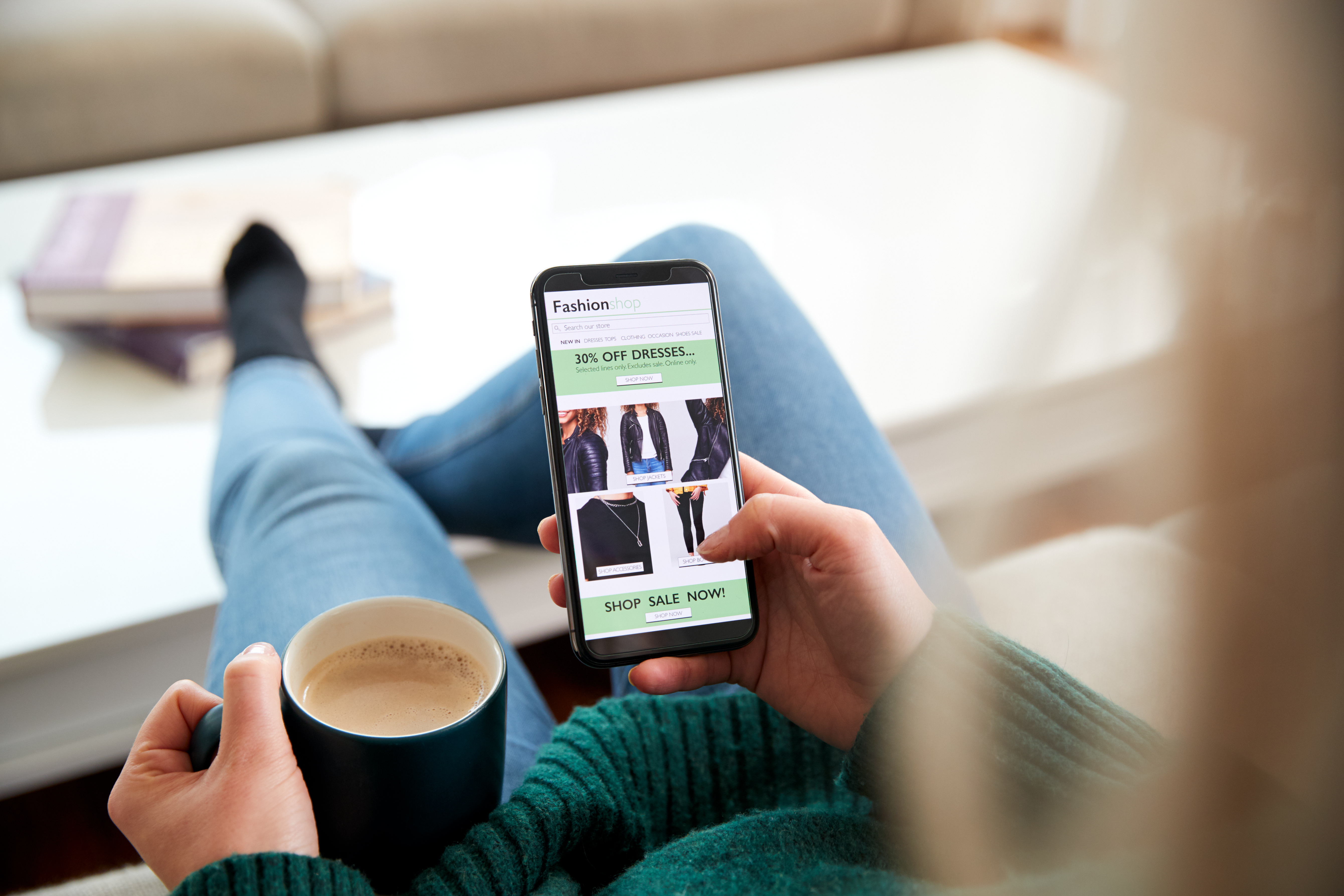 Close Up Of Woman Shopping For Clothes Online Using Mobile Phone App