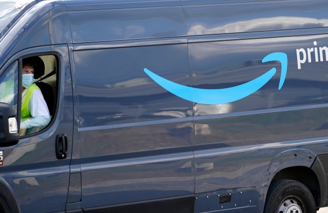 An Amazon Prime logo appears on the side of a delivery van as it departs an Amazon Warehouse location, Thursday, Oct. 1, 2020, in Dedham, Mass., (AP Photo/Steven Senne)