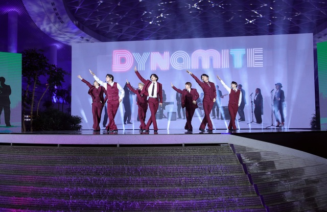 RM, V, Jimin, Jungkook, Jin, J-Hope, and Suga of BTS perform onstage.