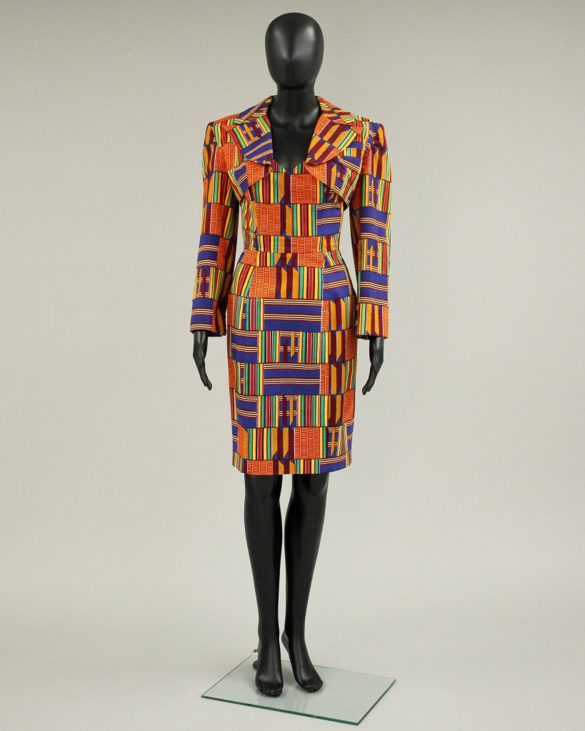 """Silk screen printed kente suit set by Patrick Kelly, as seen in Sian Browns """"Black excellence"""" exhibition."""
