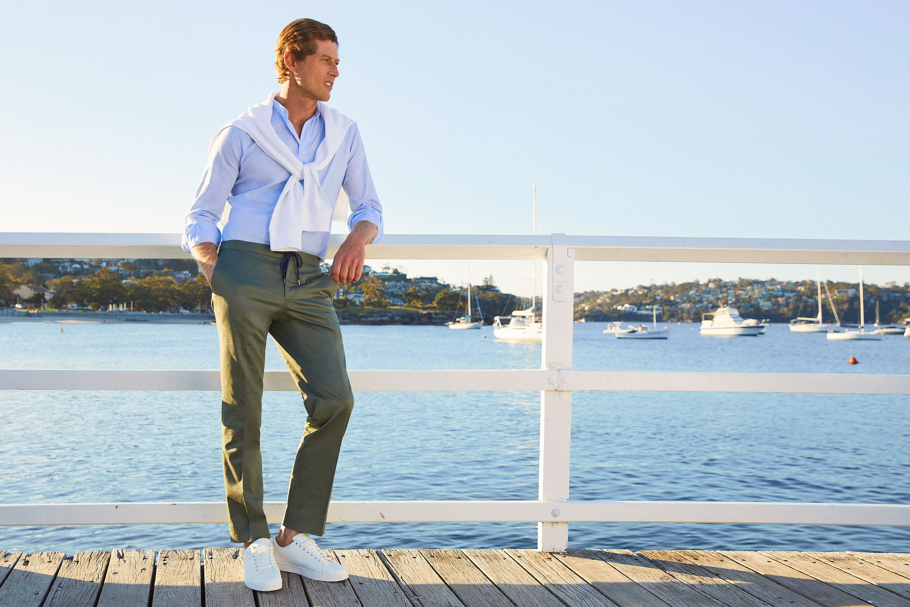 """InStitchu, an Australian custom clothing brand, is doing its part to help its pandemic-weary customers escape the challenges of living in a coronavirus world. The Sydney-based company's spring campaign, The Coastal Collection, is shot at Balmoral Beach and features lightweight woolen suits, deconstructed linen blazers, cotton chinos and more relaxed casual shirts for men. The campaign also showcases women's wear, a growth area for the company. """"No matter what you do for a living or where you're based, it's been a challenging year,"""" said cofounder Robin McGowan. """"With this campaign we wanted to try and capture the essence of the stunning Australian coastline and the beauty it represents. Whether that means jumping in the car — if you're allowed — and visiting some of the spots in the literal sense, or simply soaking up some of the poetry and majesty these beaches represent, we're big believers that a connection to nature is a great way to inject some positivity back into our lives."""" InStitchu operates 12 showrooms in Australia and New York City where customers can work with a stylist to create their own garments. — JEAN E. PALMIERI"""