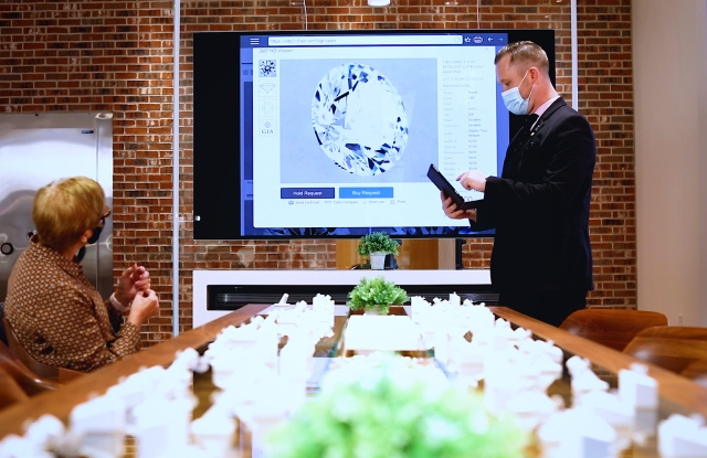 The big screen for magnifying diamonds at a co-branded Jared-James Allen store.