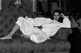 Model Kirat Bhinder poses in a fleece bed jacket with satin trim worn with over-the-knee pants designed by Lou Lou de la Falaise for Yves Saint Laurent's couture lingerie collection.