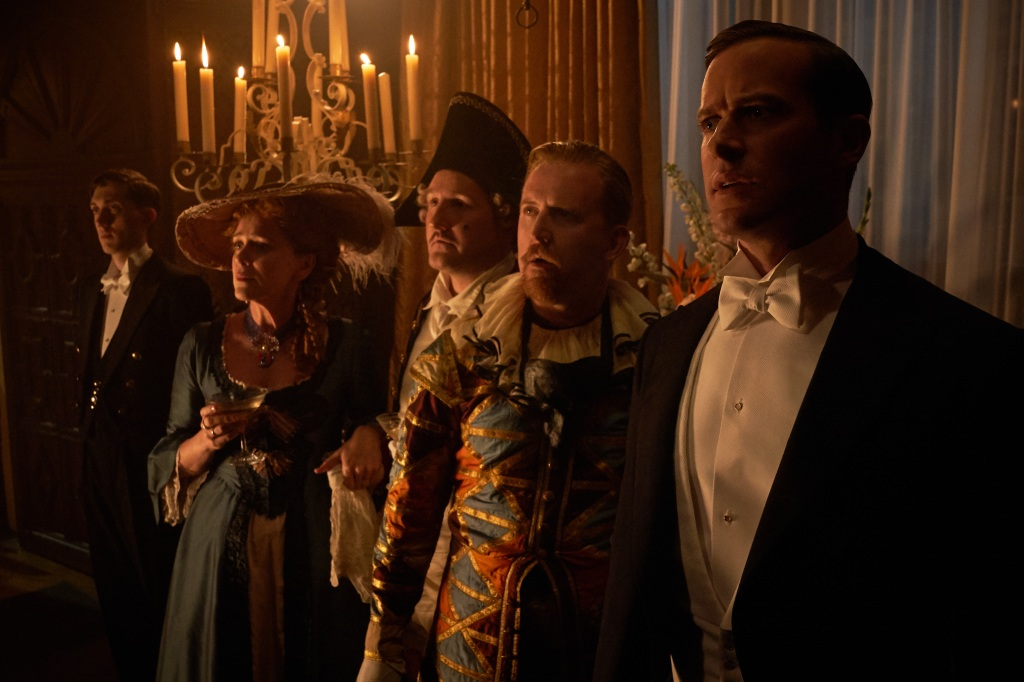 Rebecca (L to R) Keeley Haws as Beatrice Lacy, John Hollingworth as Giles Lacy, Tom Goodman-Hill as Frank Crawley, Armie Hammer as Maxim de Winter. Cr. KERRY BROWN/NETFLIX