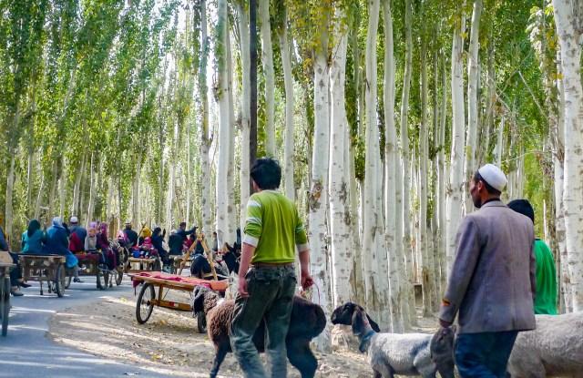 uyghurs walking in KASHGAR, CHINA