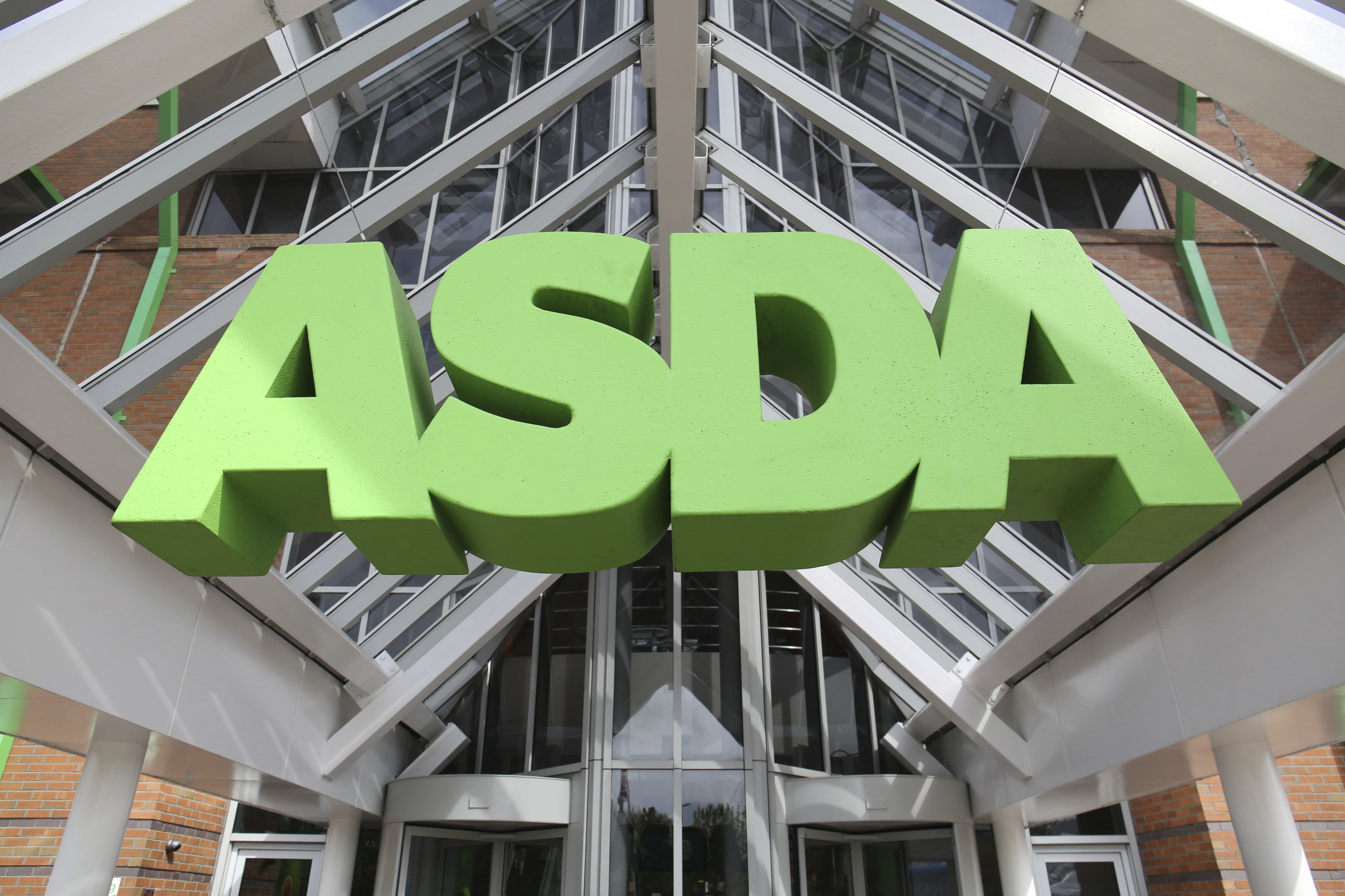 """Asda concerns. File photo dated 01/05/15 of an Asda sign. Asda's US owner has said it is """"seriously considering"""" a stock market flotation for the UK supermarket after the chain's deal to merge with rival Sainsbury's was blocked. Issue date: Wednesday May 15, 2019. Walmart - the world's biggest retailer - told Asda managers at an event on Tuesday it was mulling listing Asda, but that any preparations would """"take years"""". See PA story CITY Asda. Photo credit should read: Chris Radburn/PA Wire URN:42878219 (Press Association via AP Images)"""