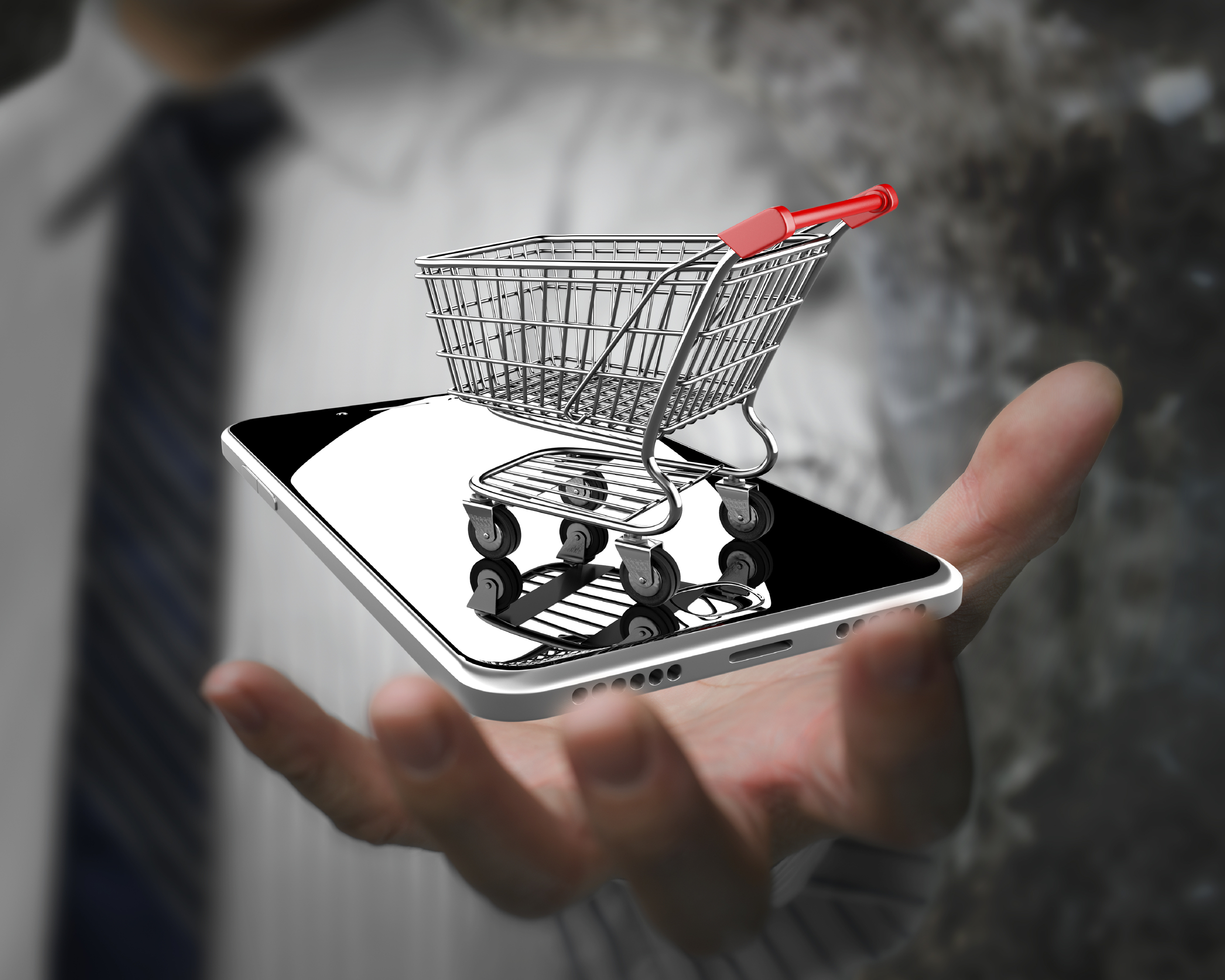 Businessman hand showing shopping cart with smart phone, on line shopping concept. (GDA via AP Images)