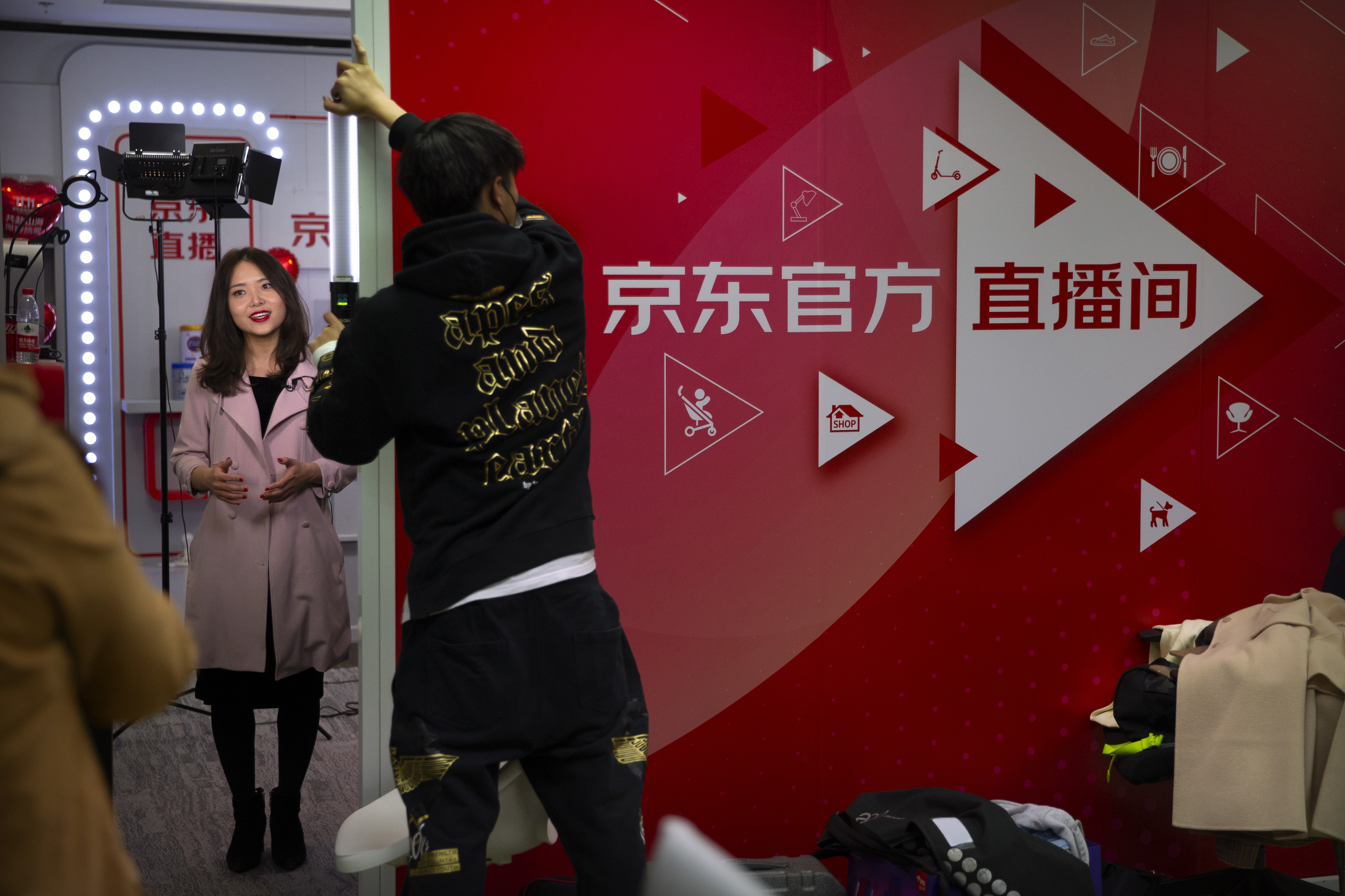A host records a promotional video for a product at the headquarters of online retailer JD.com in Beijing.