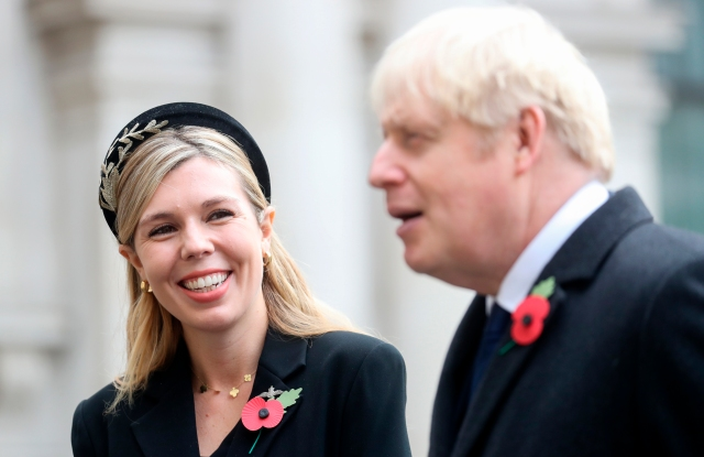 Remembrance Sunday. Prime Minister Boris Johnson with partner Carrie Symonds, talking to veterans, following the National Service of Remembrance at the Cenotaph, in Whitehall, London. Picture date: Sunday November 8, 2020. See PA story MEMORIAL Remembrance. Photo credit should read: Chris Jackson/PA Wire URN:56526282 (Press Association via AP Images)