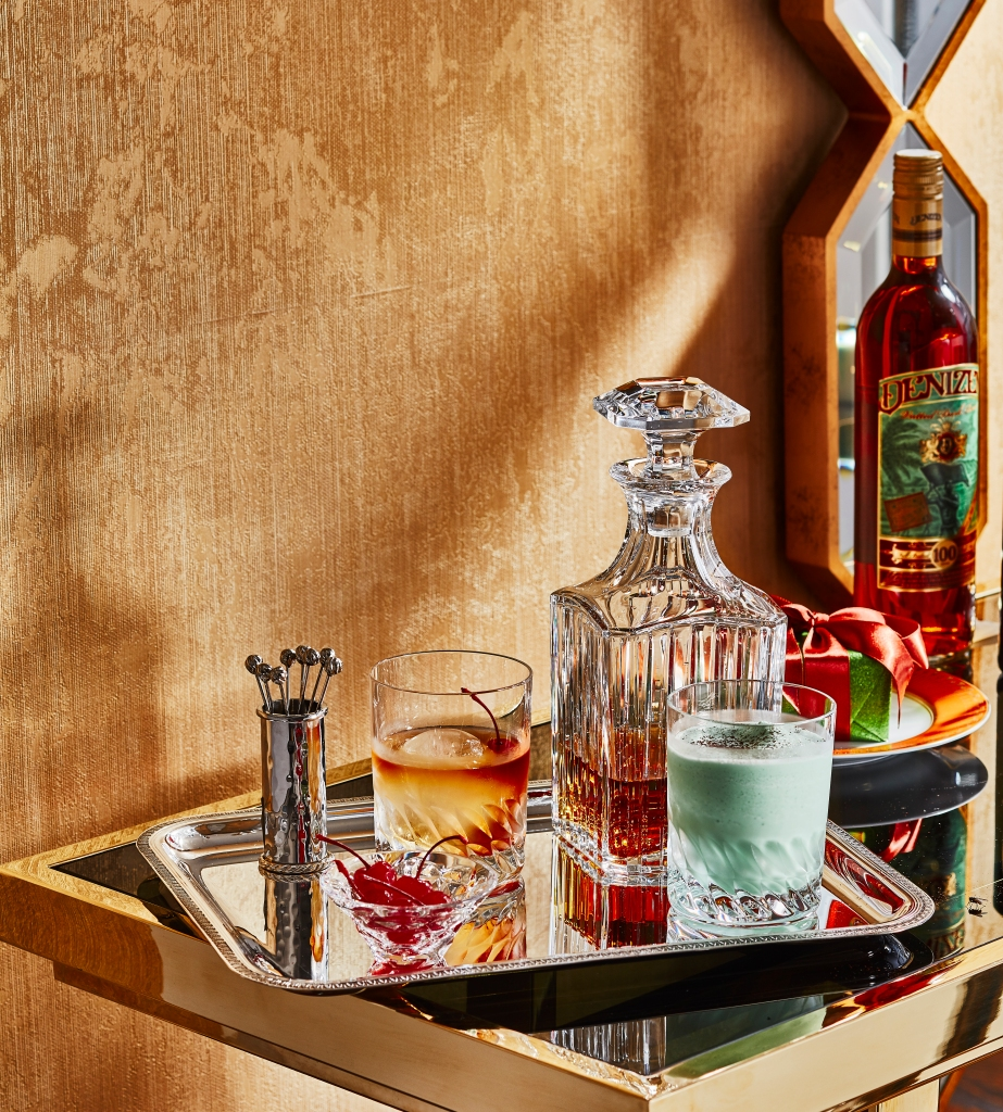 Baccarat's tumblers, Harmonie's whiskey decanter, Juliska's picks and holder and Christofle's tray.