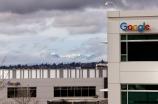 The Google campus is seen in view of the Olympic mountains breaking briefly through the clouds at the opening of the expansion of the campus Tuesday, Feb. 16, 2016, in Kirkland, Wash. The expansion doubles the size of the campus and makes Google's Puget Sound Operations the third-largest engineering center for the company in the country. The campus is home to engineering teams working on Google products that include Hangouts, Cloud, Chrome and Ads. (AP Photo/Elaine Thompson)
