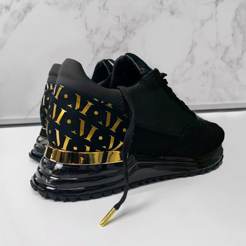 """The """"Popham"""" sneaker with a gold heel clip is a bestseller from the Mallet London collection."""