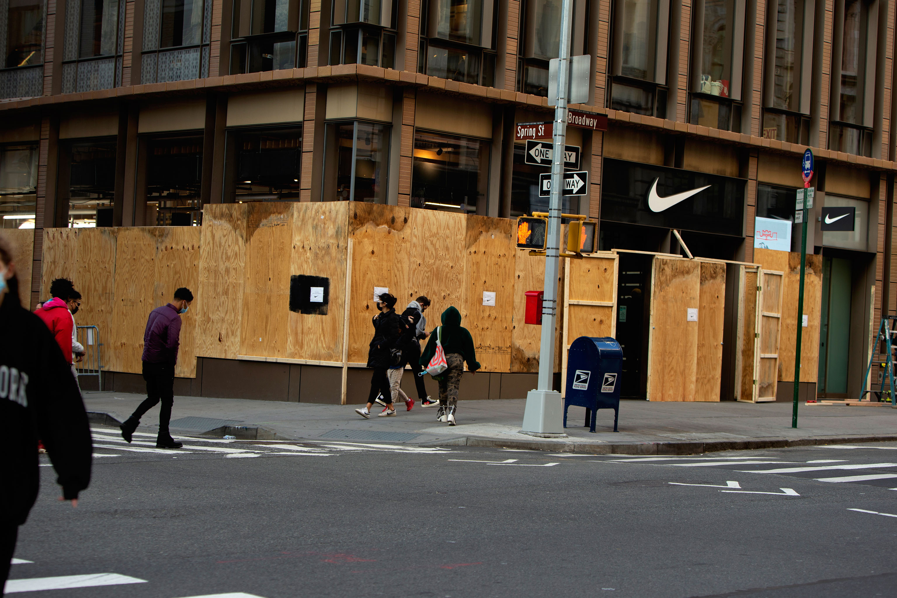 Boarded up stores across SoHo in New York .