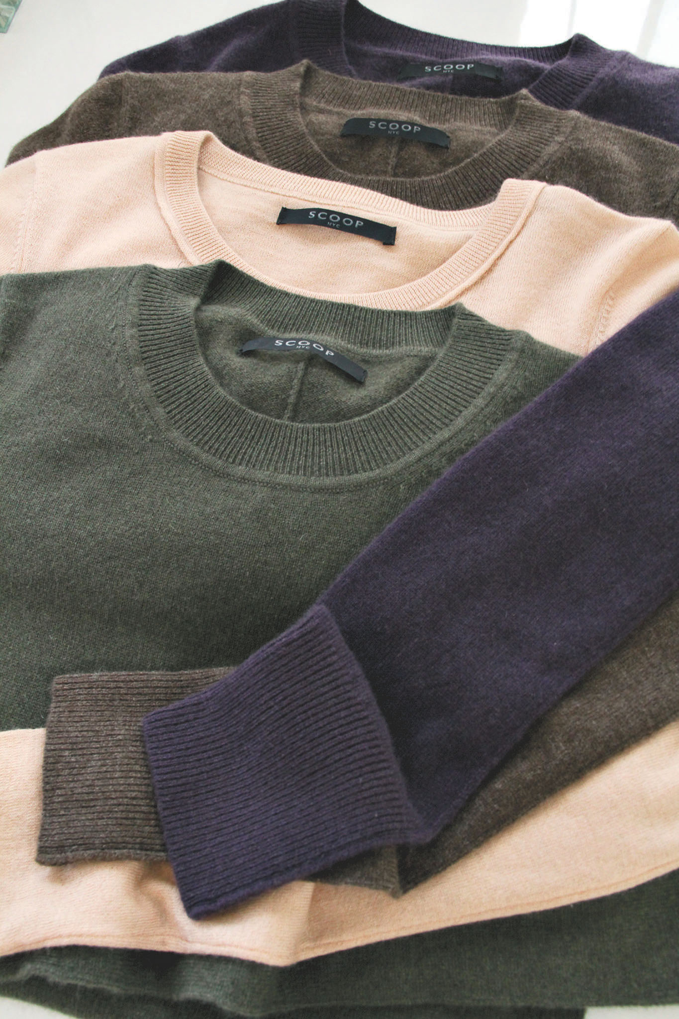 Assortment of cashmere crewneck sweaters by Scoop.