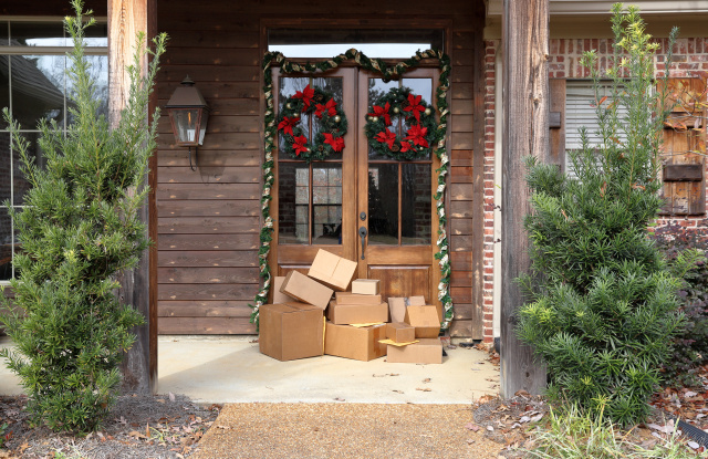 Boxes and packages next to front door during holiday christmas season.