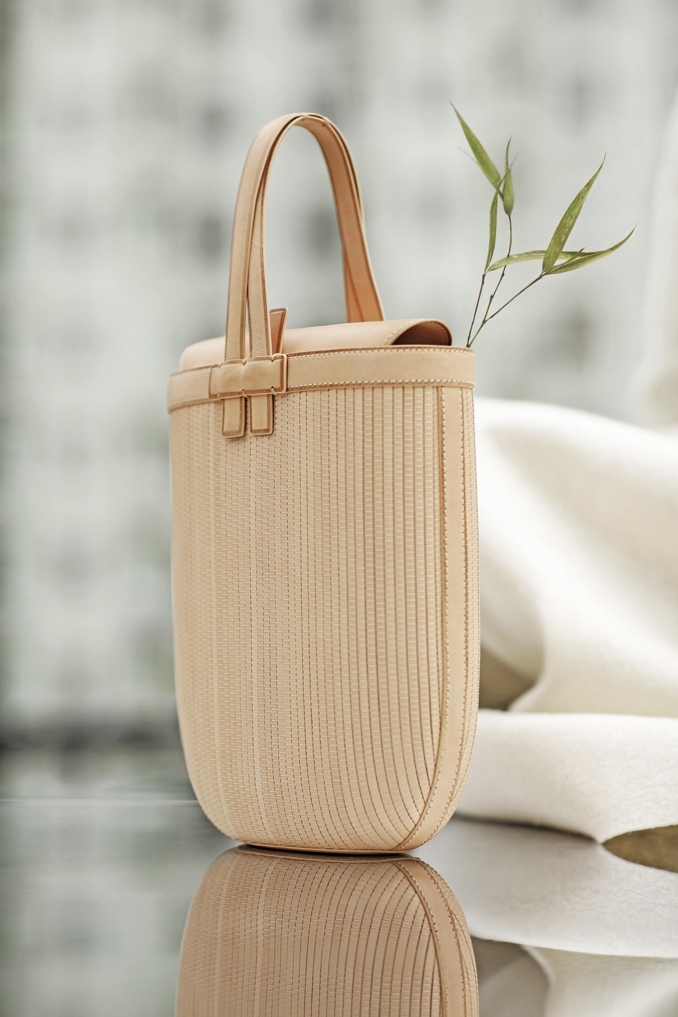 Lan Yue woven leather handbag by Shang Xia