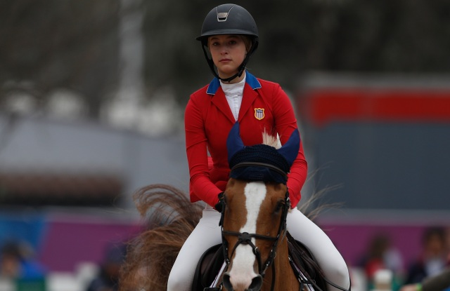 Eve Jobs of the U.S. warms up her horse Venue d'Fees des Hazalles as she prepares to compete in the first classification round of individual and team equestrian jumping at the Pan American Games in Lima, Peru, Tuesday, Aug. 6, 2019. (AP Photo/Rebecca Blackwell)
