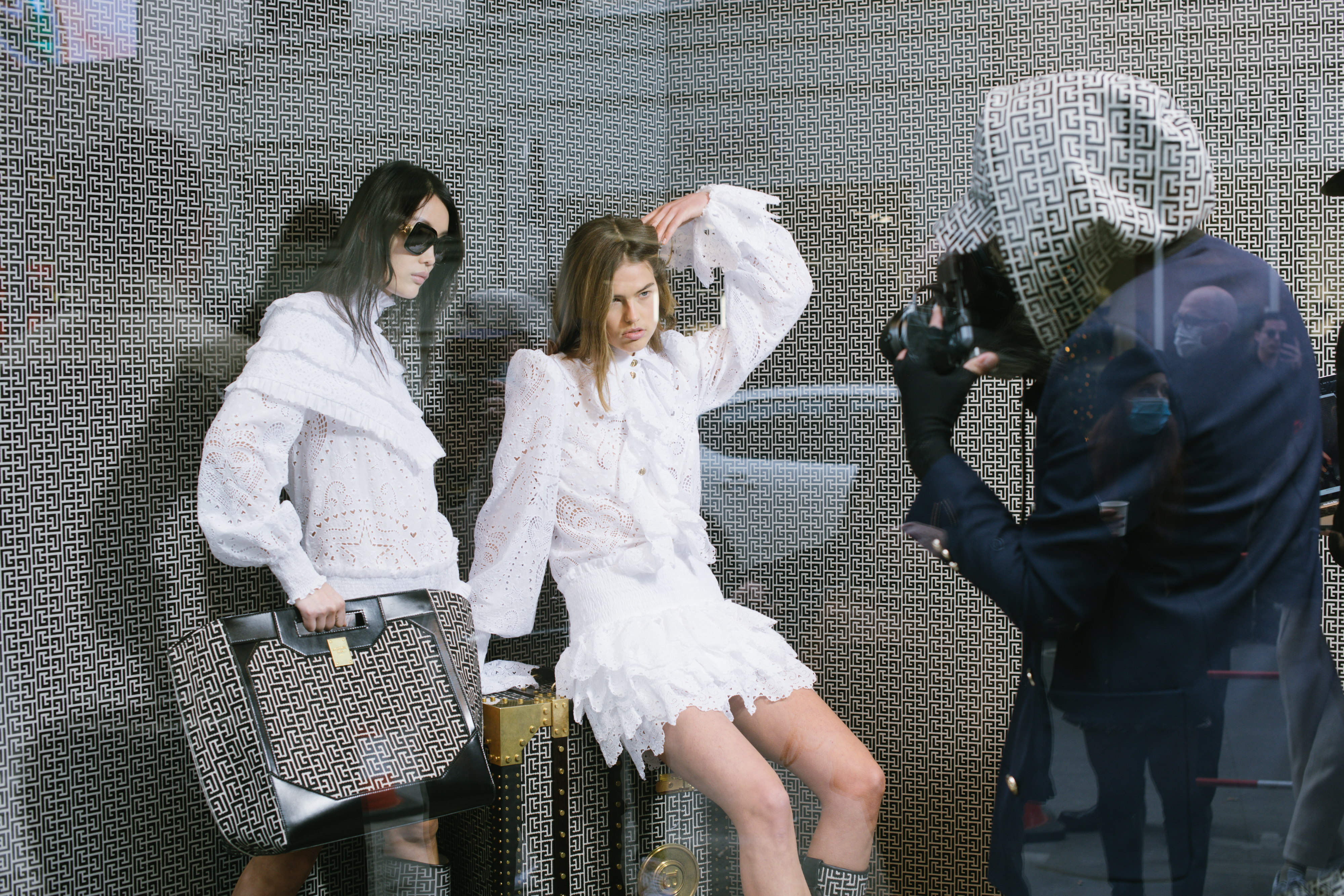Olivier Rousteing shooting Balmain Pre-Fall 2021 collection in the windows of its Rue Saint-Honoré boutique.