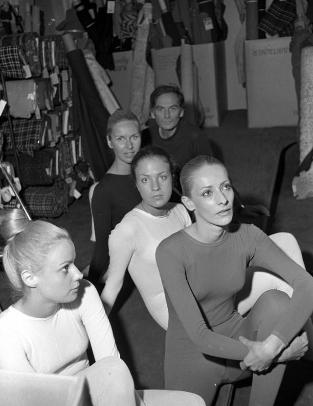 Fashion designer Pierre Cardin at his studio in Paris with models