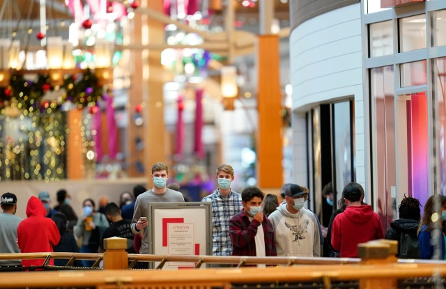 Last-minute shoppers wear face masks as they search for Christmas Eve deals in Park Meadows Mallin Lone Tree, Colorado.