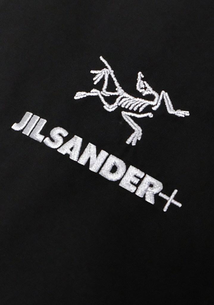 The logo of the Jil Sander+ and Arc'teryx capsule