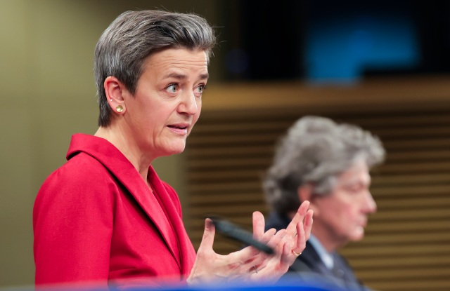 European Commissioner for Europe fit for the Digital Age Margrethe Vestager, left, talks next to European Commissioner for Internal Market Thierry Breton during a news conference on Digital Services Act and the Digital Markets Act at the European Commission headquarters in Brussels, Tuesday, Dec. 15, 2020. (AP Photo/Olivier Matthys, Pool)