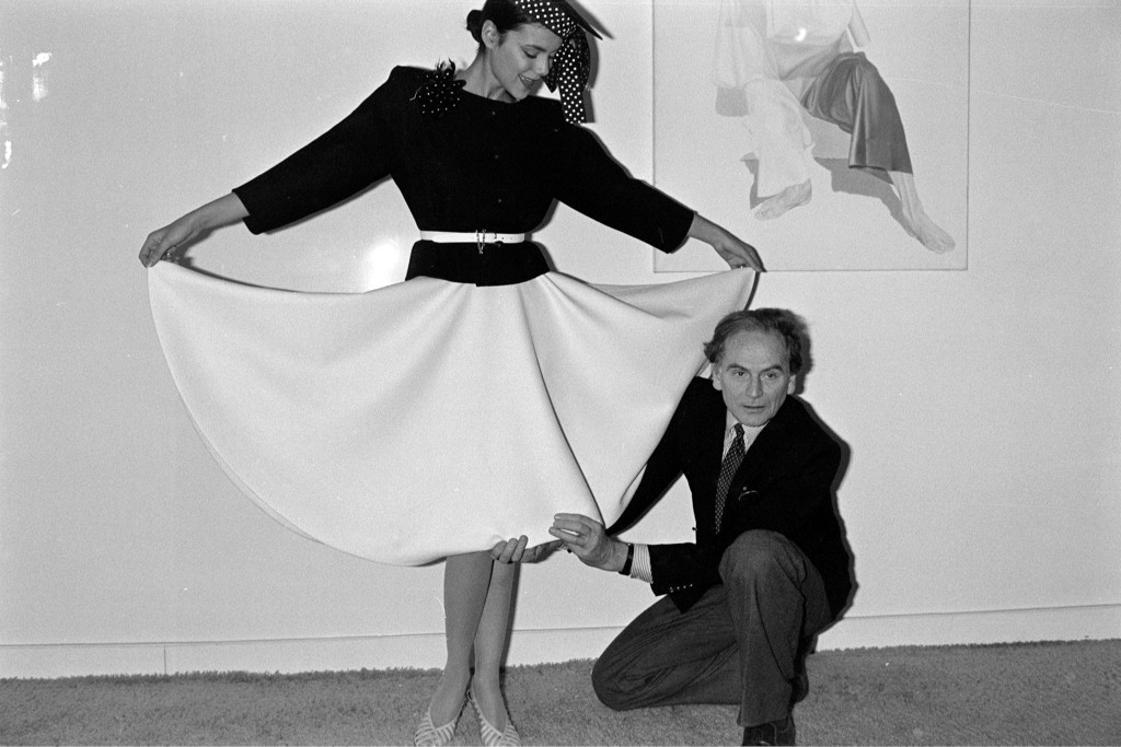 Designer Pierre Cardin fits a model in 1980