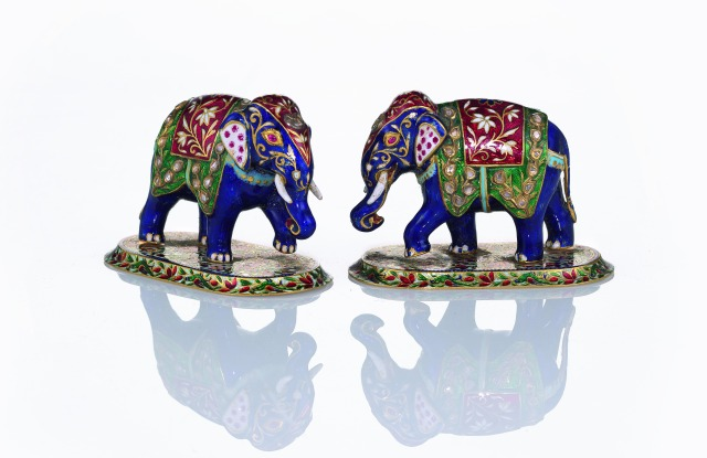 A pair of jewelled gold and enamel elephants Jaipur 1946.