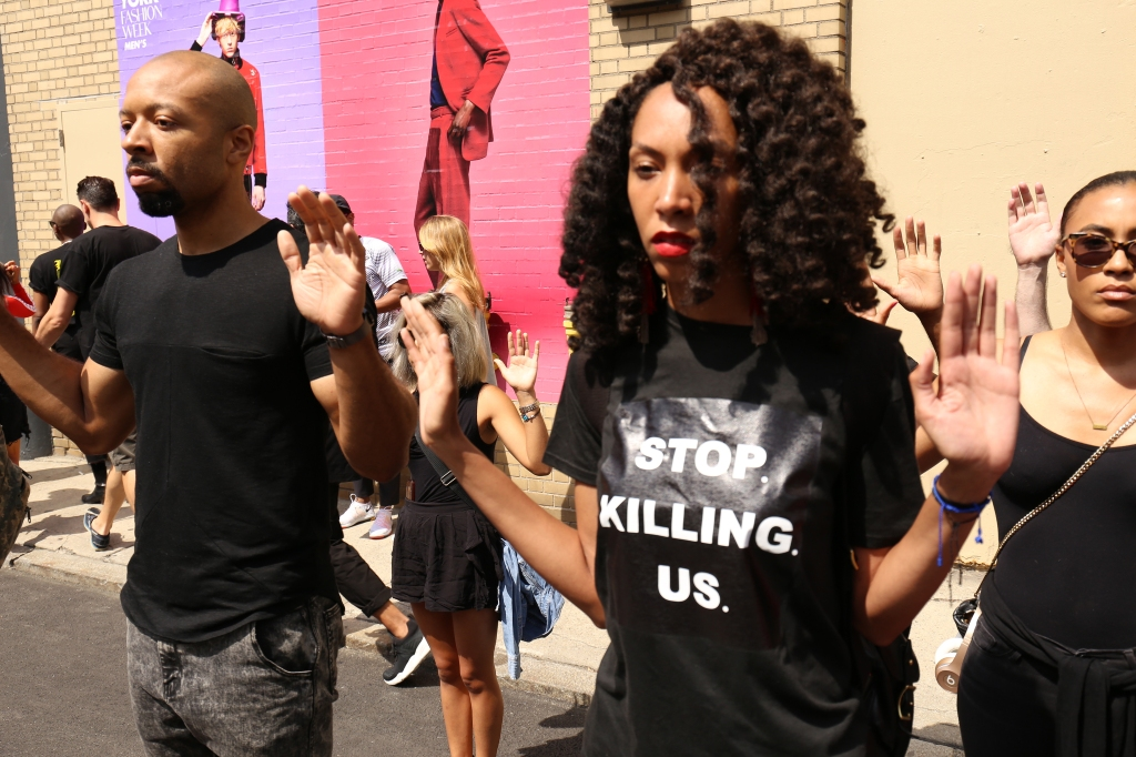 Atmosphere at a demonstration outside of Men's New York Fashion Week on July 12, 2016.