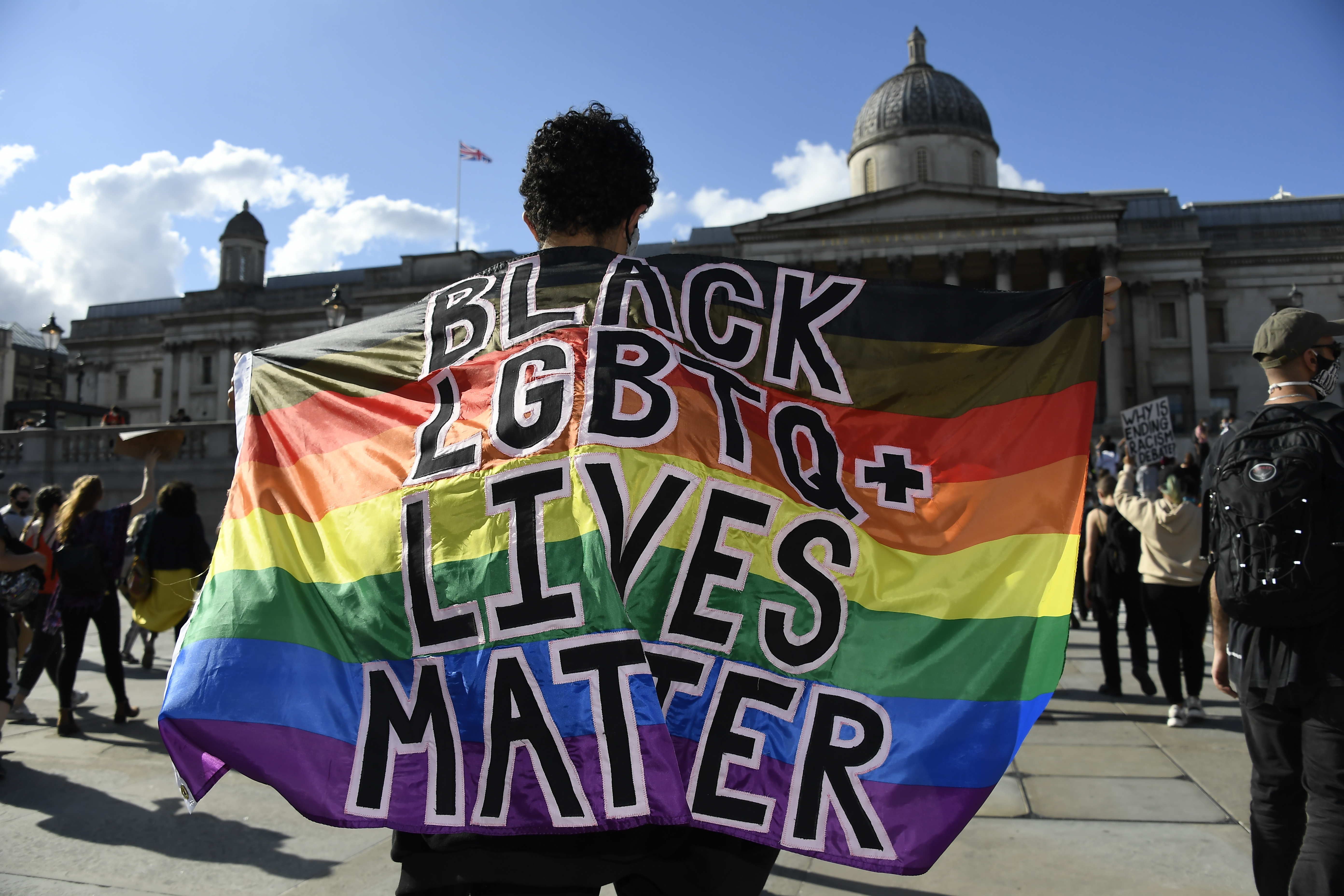 People participate in a rally at Trafalgar Square in central London, organized by Black Lives Matter, in the wake of the killing of George Floyd by police officers in Minneapolis.