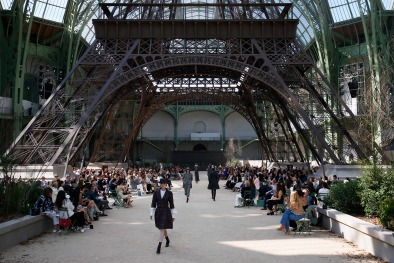 A model wears a creation for Chanel's Haute Couture Fall/Winter 2017/2018 fashion collection presented under a replica of the Eiffel Tower at the Grand Palais in Paris Tuesday, July 4, 2017. (AP Photo/Francois Mori)
