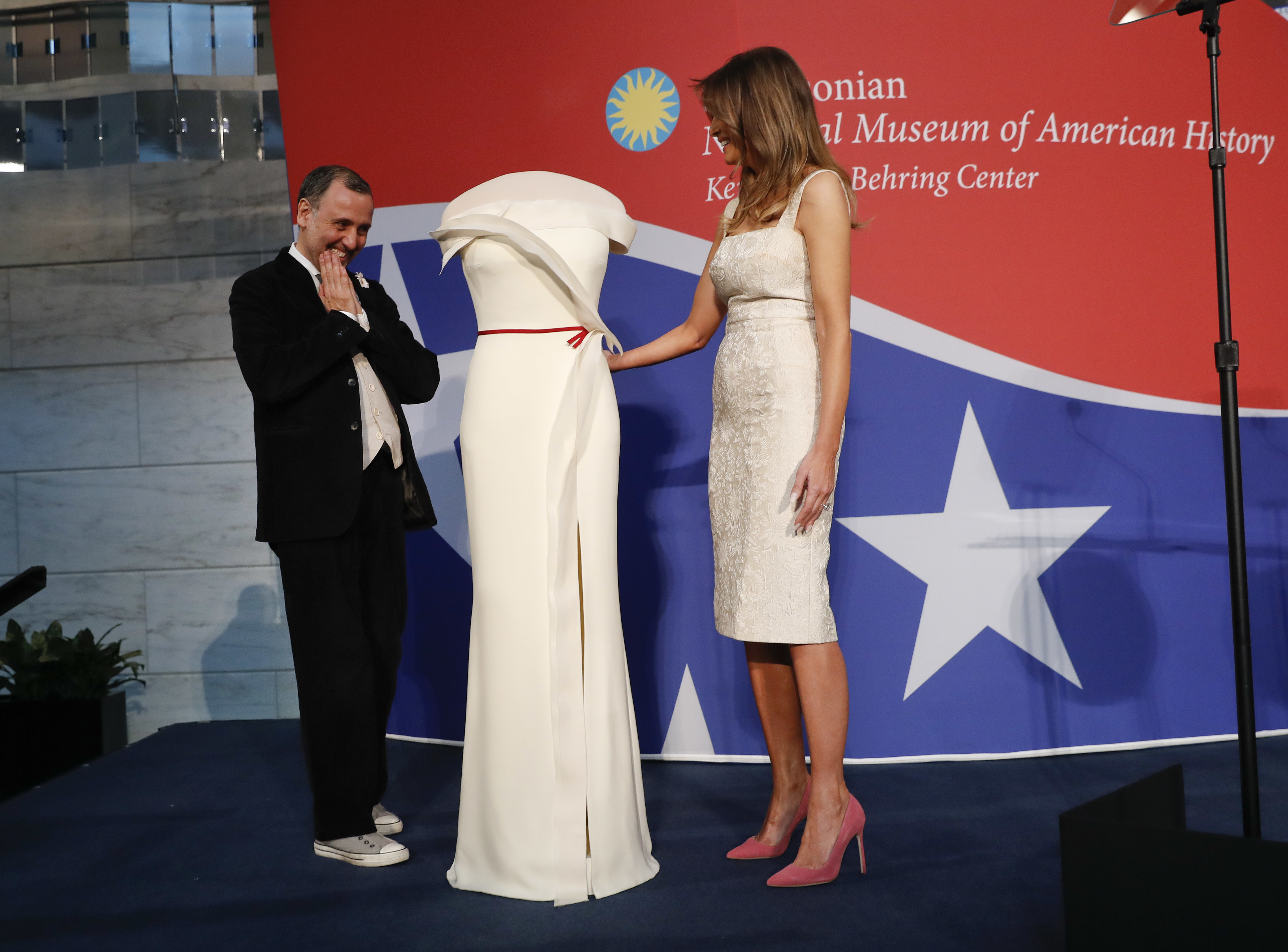 First lady Melania Trump, right, donates her inaugural gown, designed by Herve Pierre, right, to the First Ladies' Collection at the Smithsonian's National Museum of American History, during a ceremony in Washington, Friday, Oct. 20, 2017. (AP Photo/Pablo Martinez Monsivais)