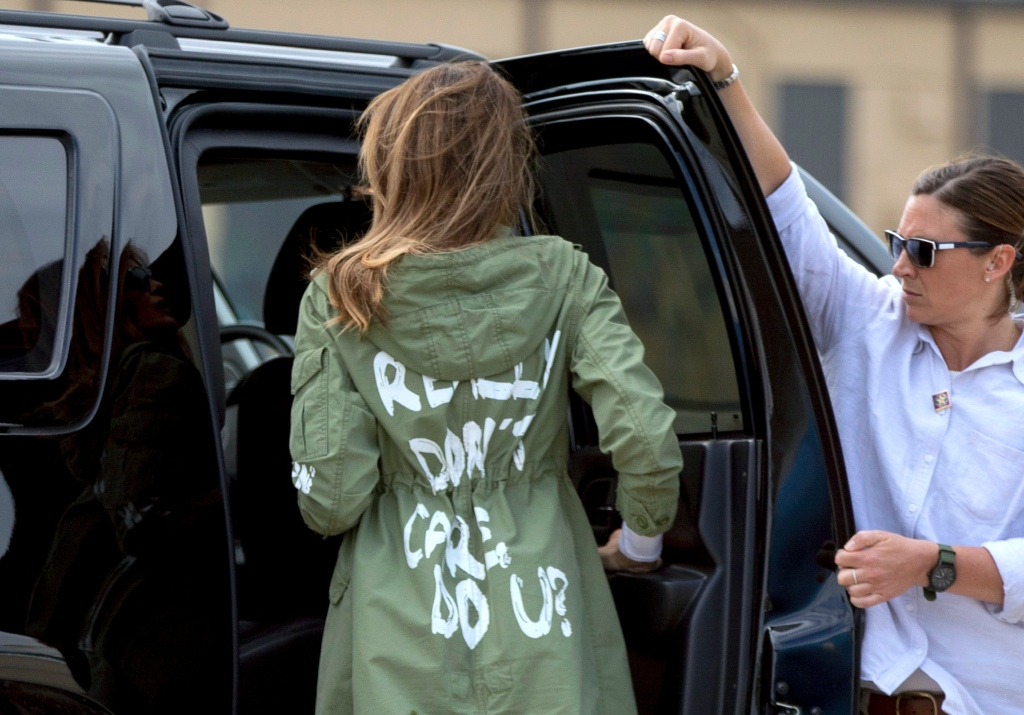 "FILE - In this June 21, 2018, file photo, First lady Melania Trump arrives at Andrews Air Force Base, Md., wearing a jacket that reads ""I REALLY DON'T CARE, DO U?"" after visiting a children's center in McAllen, Texas. A Melania Trump spokeswoman is asking people to boycott Atlanta rapper T.I. because of his promotional album video that shows a woman resembling the first lady stripping in the oval office. WXIA-TV reports the director of communications for Melania Trump, Stephanie Grisham, tweeted Saturday asking how the video was acceptable. (AP Photo/Andrew Harnik, File)"