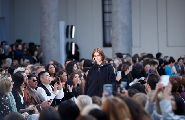 Model Kaia Gerber wears a creation as part of Max Mara's Fall/Winter 2020/2021 collection, presented in Milan, Italy, Thursday, Feb. 20, 2020. Sitting at left is Anna Wintour. (AP Photo/Antonio Calanni)