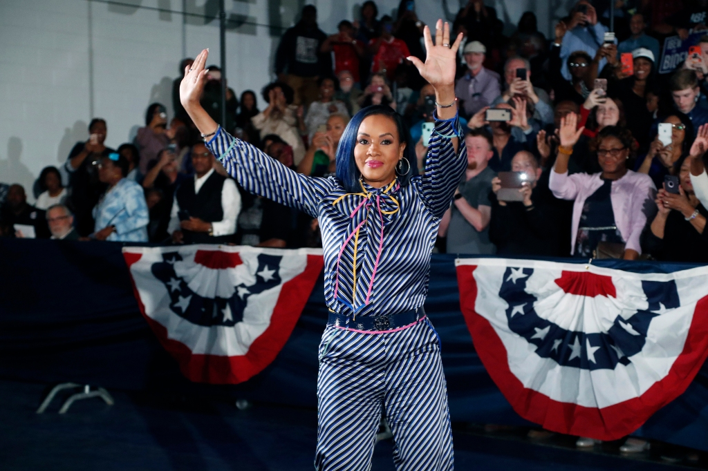 Actress Vivica A. Fox waves to supporters of Democratic presidential candidate and former Vice President Joe Biden before he speaks at Tougaloo College.