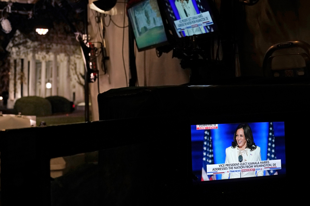 Kamala Harris delivering her victory speech in Washington, wearing a Carolina Herrera suit and blouse.