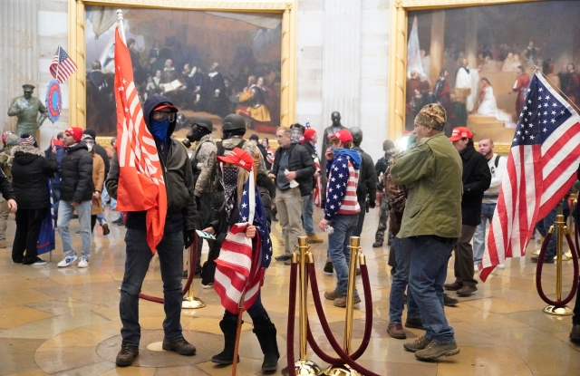 Protestors enter the Capitol building during a joint session of Congress in Washington, DC on Wednesday, January 6, 2021.