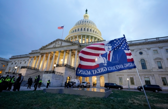 A flag left by pro-Trump rioters outside the Capitol building they bombarded.