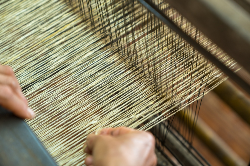 Weaving silk in traditional way in Vietnam. Vietnamese silk processing.