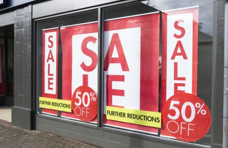store with sale signs