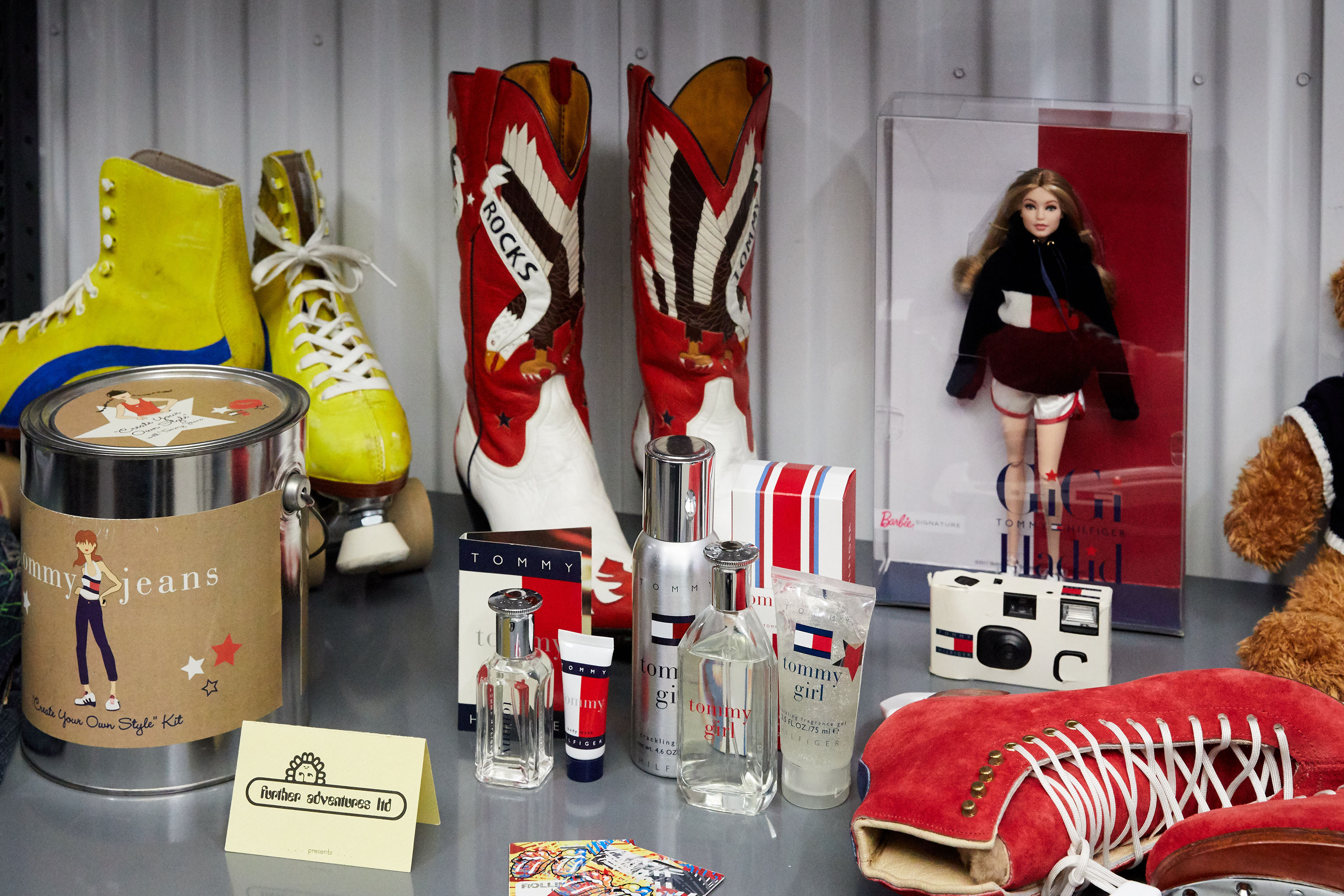 Various Tommy Hilfiger collectibles including the cowboy boots worn by Naomi Campbell on the runway.