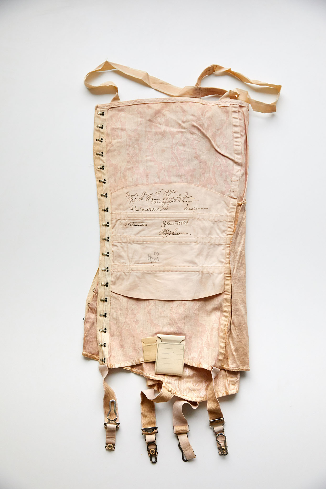 Warner's corselette, signed on Aug. 1, 1924, by company president John Field and others.