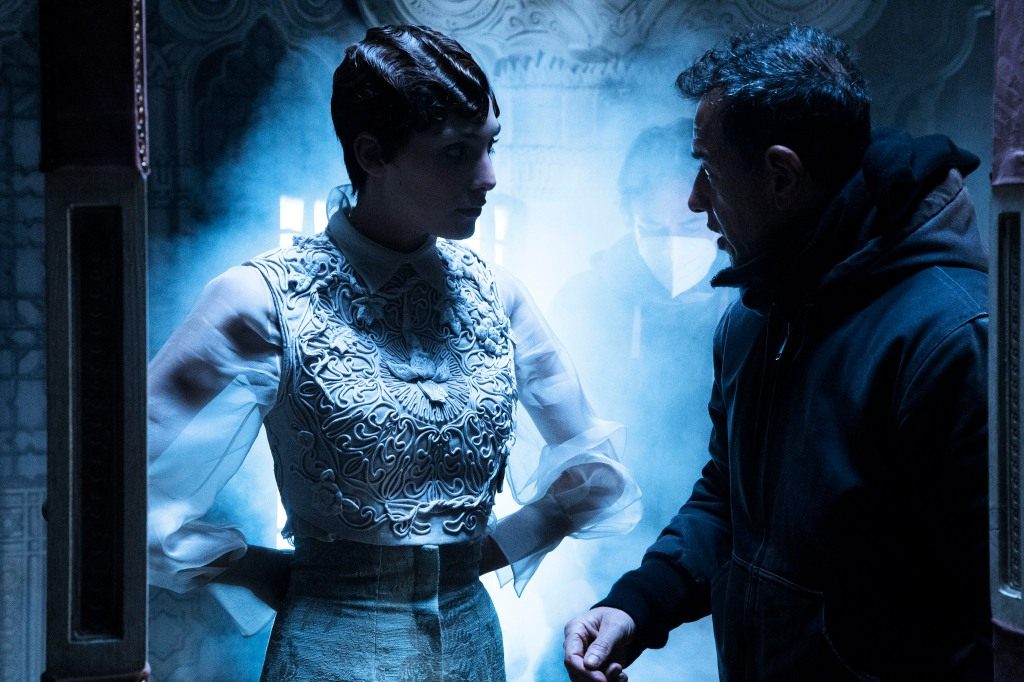 Director Matteo Garrone talks to a model on the set of his short film for Dior.