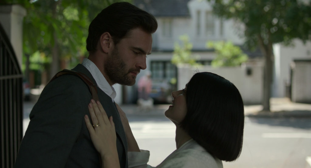"Tom Bateman and Eve Hewson star in ""Behind Her Eyes."""