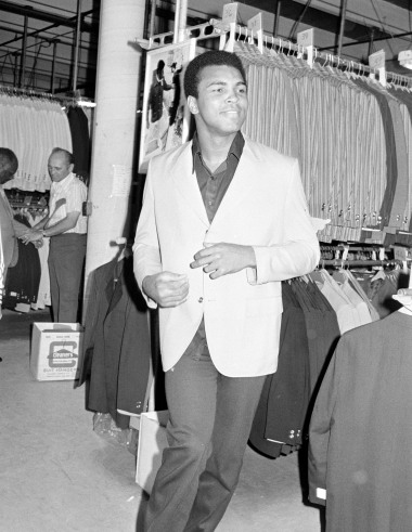 Boxer Muhammad Ali shops for a new suit before his fight with Joe Frazier on March 8,1971 at Madison Square Garden. Ali was known to go on shopping sprees before his fights.