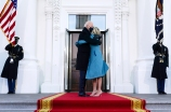 President Joe Biden hugs first lady Jill Biden as they arrive at the North Portico of the White House, Wednesday, Jan. 20, 2021, in Washington. (AP Photo/Evan Vucci)