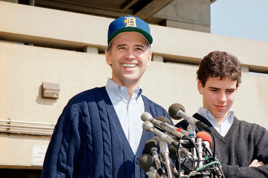 President-elect Joseph Biden, wearing a University of Delaware baseball cap, leaves Walter Reed Army Hospital accompanied by his son Hunter Biden in Washington, 1988.