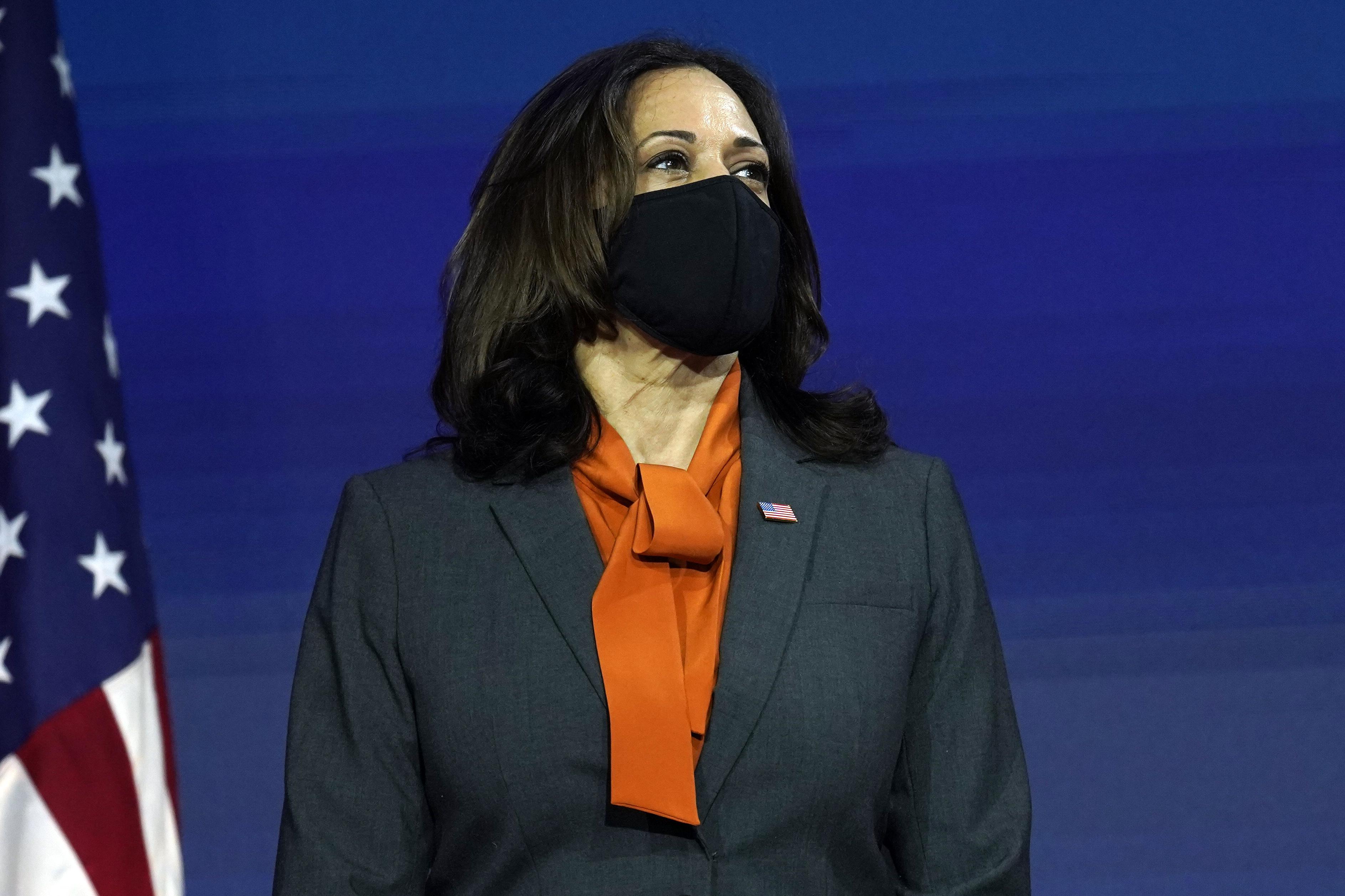Nov. 9, 2020 during election Biden win celebration wearing white Carolina Herrera pantsuit.